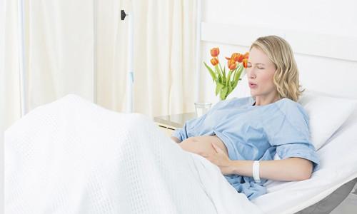 Чому тягне низ живота при вагітності?